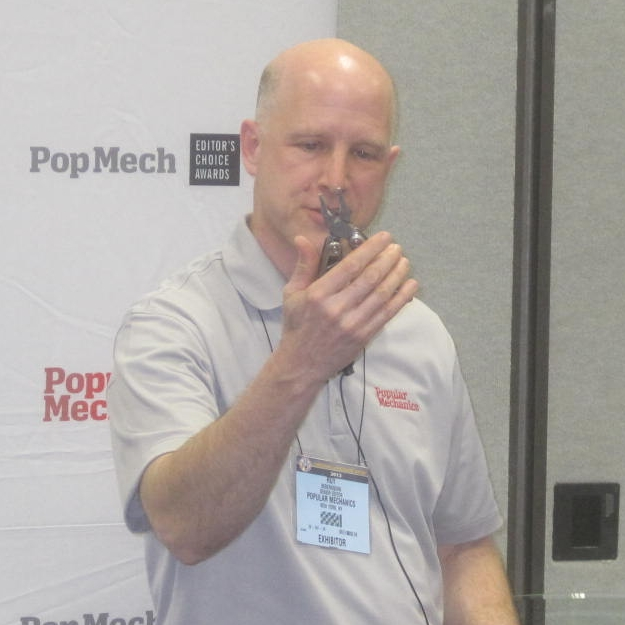 Popular Mechanics' Senior Home Editor Roy Berendsohn describes the Pro Pocket Pliers features before presenting the Editor's Choice Award to COAST at the National Hardware Show on May 1st.